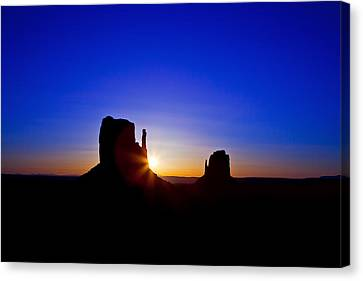 Sunrise Over Monument Valley Canvas Print by Susan Schmitz