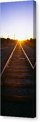 Sunrise Over Railroad Tracks Canvas Print by Panoramic Images