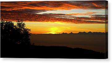 Sunrise Over The Alps Canvas Print by Charles Lupica
