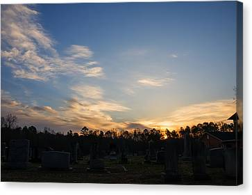 Sunrise Over The Cemetary Canvas Print by Chris Flees