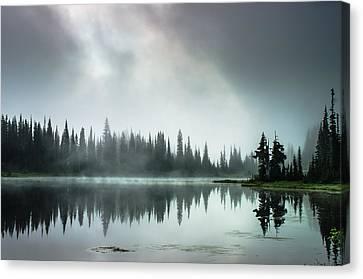 Sunrise Through The Mist Canvas Print by Brian Xavier