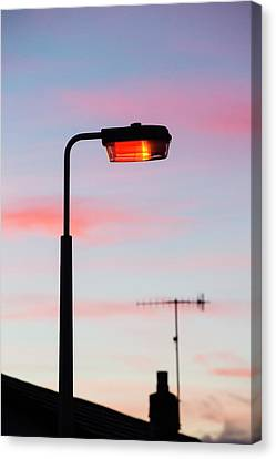 Sunset And A Street Light In Ambleside Canvas Print by Ashley Cooper