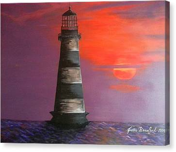Sunset And Lighthouse Canvas Print by Joetta Beauford