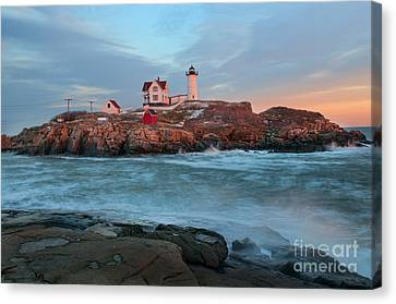 Sunset At Nubble Lighthouse Canvas Print by Sharon Seaward