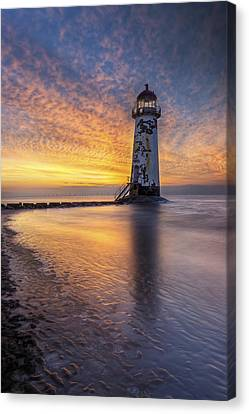 Sunset At The Lighthouse Canvas Print by Ian Mitchell
