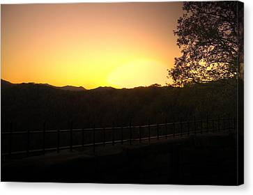 Canvas Print featuring the photograph Sunset Behind Hills by Jonny D