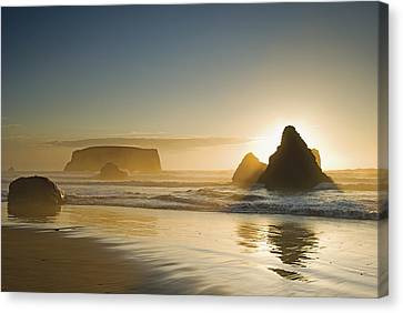 Sunset Behind Offshore Rocks Bandon Canvas Print by Philippe Widling