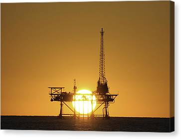Canvas Print featuring the photograph Sunset Behind Oil Rig by Bradford Martin