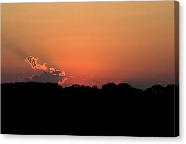 Sunset Clouds Canvas Print by Mark Russell