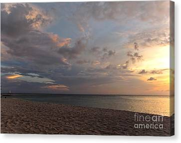 Sunset Grand Cayman Canvas Print by Peggy Hughes