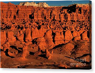 Sunset Light Turns The Hoodoos Blood Red In Goblin Valley State Park Utah Canvas Print by Dave Welling