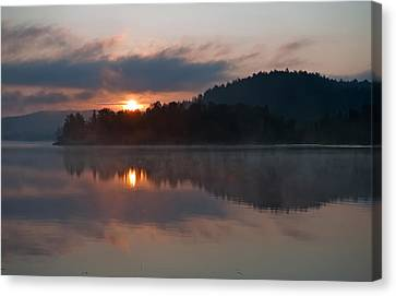 Sunset On The Lake Canvas Print by Marek Poplawski