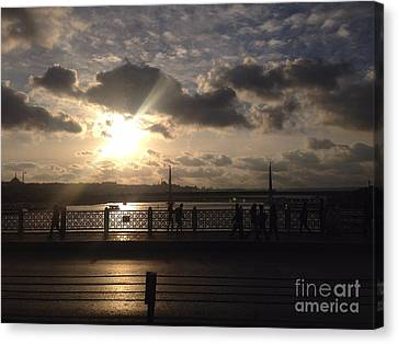 Reflection Of Sun In Clouds Canvas Print - Sunset Over Istanbul Turkey by John Telfer