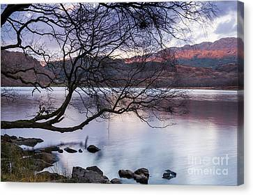 Sunset Over Lake Dinas Canvas Print by Trevor Chriss