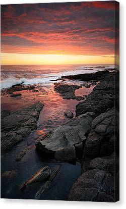 Sunset Over Rocky Coastline Canvas Print by Johan Swanepoel