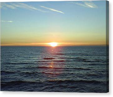 Sunset Over Sea Canvas Print by Gordon Auld