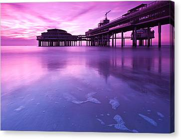 Sunset Over The Pier Canvas Print by Mihai Andritoiu