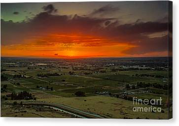 Sunset Over The Valley Canvas Print by Robert Bales