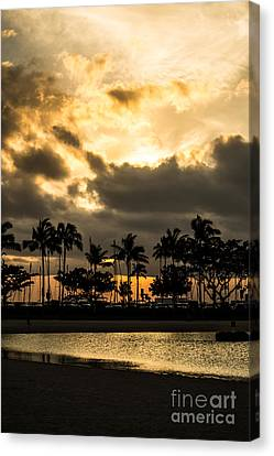 Sunset Over Waikiki Canvas Print by Angela DeFrias