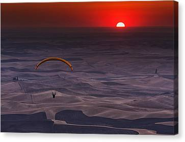 Sunset Paragliding Canvas Print by Mark Kiver