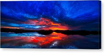 Sunset Reflections Canvas Print by Mark Andrew Thomas
