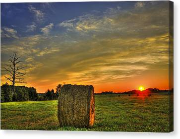 Sunset Round Bale Lick Skillet Road Canvas Print by Reid Callaway