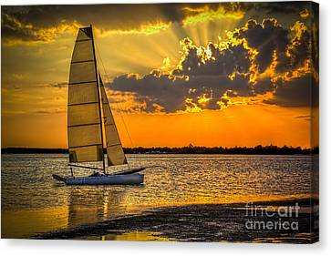 Sunset Sail Canvas Print by Marvin Spates
