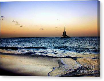 Canvas Print featuring the photograph Sunset Sailing In Aruba by Polly Peacock