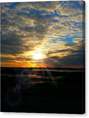 Sunset Sets Off Cloud Explosion Canvas Print by Joetta Beauford