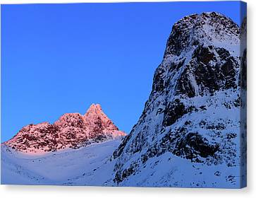 Sunset In Norway Canvas Print - Sunset Shines On Snow-covered Rugged by Babak Tafreshi