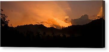 Sunset Silhouette Canvas Print by Kim Lagerhem