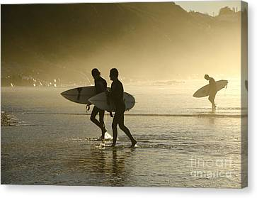 Sunset Surfers Biarritz Canvas Print by Perry Van Munster