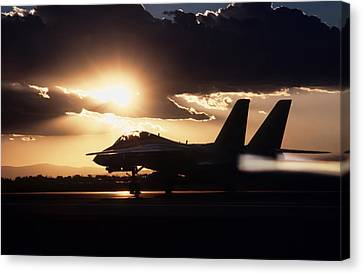 Sunset Take Off Canvas Print by Peter Chilelli