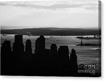 Sunset View Of Lower Manhattan Financial District Bay New York Silhouette City Canvas Print by Joe Fox