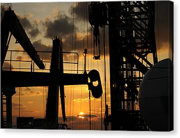 Sunset Viewed From An Oil Rig Canvas Print by Bradford Martin