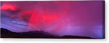 Sunset With Lightning And Rainbow Four Canvas Print by Panoramic Images