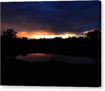 Sunsets Reflection Canvas Print by Linda Brown