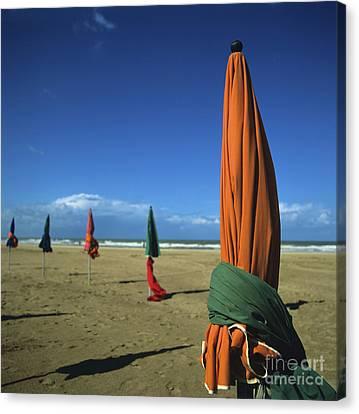 Sunshade On The Beach. Deauville. Normandy. France Canvas Print by Bernard Jaubert