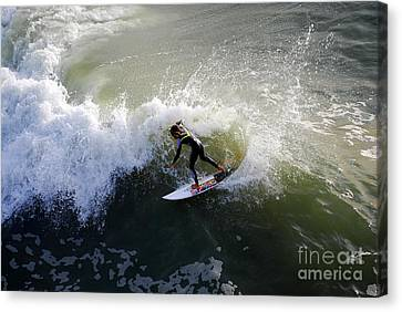 Surfer Boy Riding A Wave Canvas Print by Catherine Sherman