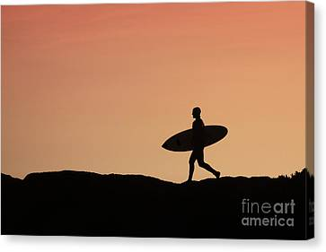 Surfer Crossing Canvas Print by Paul Topp