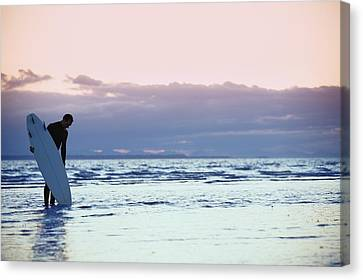 Surfer In The Shallow Water Canvas Print by Daniel Sicolo