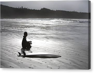 Surfer Meditating On Beach, Cox Bay Canvas Print by Deddeda
