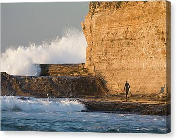 Surfer Sizing Up The Challenge Canvas Print by Tom Norring