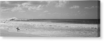 Surfer Standing On The Beach, North Canvas Print by Panoramic Images