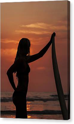 Surfer Sunset Silhouette Canvas Print by Lee Kirchhevel