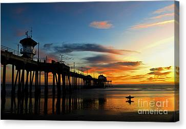 Surfer Watching The Sunset Canvas Print by Peter Dang
