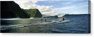 Surfers In The Sea, Hawaii, Usa Canvas Print by Panoramic Images