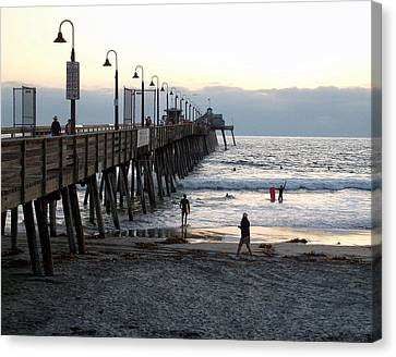 Surfing At Dusk Canvas Print
