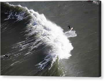 Surfing At Fort Point Viewed Canvas Print by Panoramic Images