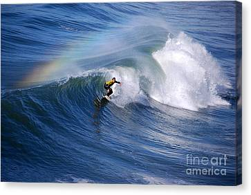 Surfing Under A Rainbow Canvas Print by Catherine Sherman
